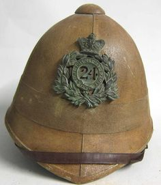 Original 24th Foot Rorke's Drift helmets are extremely rare and command very high prices when the do come on the market, which is a once in a lifetime. This reproduction Zulu war Foreign Service helmet has been made to look over 130 years old. The helmet has been treated with several coats of 'blanco' (whitening mixture) and then treated as the troops did by toning it down to a khaki colour. www.warhats.com