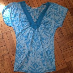 SALE  Anthropologie Boho Knit Top NWOT NWOT. Testament by Anthropologie. Blue and white damask knit top. Crochet lace pattern around neck. Gentle and loose ruching around bust line. Short sleeves. If you have questions, please ask. Anthropologie Tops