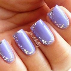 Pretty Violet nails with rinestones.