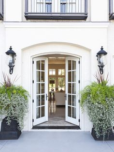 The front door home opens into an airy living space, where a series of French doors lead to a courtyard garden. Style At Home, Exterior Design, Interior And Exterior, Exterior Doors, Modern Interior, Design Your Home, House Design, Future House, My House