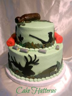 Groom's Cake for a Hunter - A buttercream iced cake with fondant accents. The shotgun shells are fondant wrapped around rkt. TiaCake did a beautiful deer hunting cake which was the inspiration for this cake.