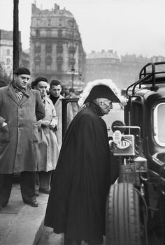Henri Cartier-Bresson  FRANCE. Paris. 1953. A member of the French Academy arriving at the Notre-Dame Cathedral