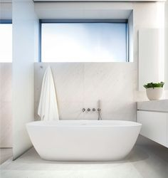 Tadao Ando 152 Elizabeth Street, NYC-The bathrooms are inspired by spa chambers and include Japanese-style soaking tubs.