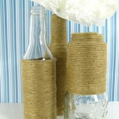 Make some simple and cheap jute wrapped recycled bottles that look like their from pottery barn. - I have some extra yarn that would probably look cool.