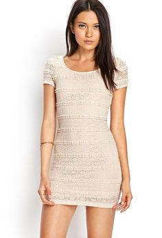 Sweet and femme, this crochet lace bodycon dress features a round neckline and cutout back with a...