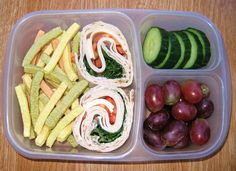 In our lunch box: Turkey roll up sandwiches on flatbread with a side of baked veggie sticks. Sprinkle a little salt on the cucumbers for taste, and add grapes for a splash of color.