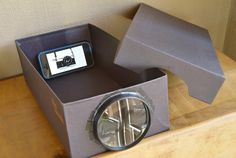 Iphone projector made our of a shoe box and a magnifying glass!