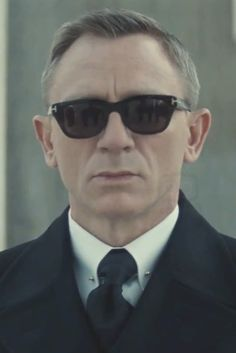 Daniel Craig wearing  Tom Ford Double Breasted Overcoat, Tom Ford Flynn Sunglasses