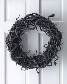 Take a basic wreath and go to the Dollar Store and buy packages of rubber snakes and hot glue the snakes to make a perfect wreath!