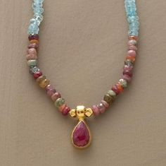 ruby warmed by matte 24kt gold drips from a necklace of tourmalines and aquamarines.  from Sundance catalog.