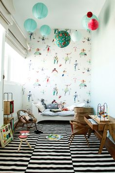 love the wood teeny tiny furniture, small toddler bed, black and white rug, colorful wall feature, cute toys too :)