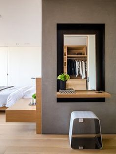 Domino Effect: How a Bedroom Refresh Jump-Started a Whole-House Remodel For a Tech Exec - Photo 5 of 14 - Like the bed and built-in nightstand, the door is by Lloyd's Custom Woodwork. The WGS stool near the vanity is by Gallotti&Radice.