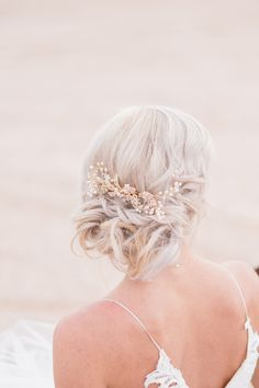 Tiny little pearls create delicate flowers that swirl around ornate, crystal-studded leaves. The simple comb allows you to arrange your #weddings hairstyle in many ways. The elegant design accentuates your perfect style, standing out against your lovely head.