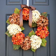 DIY Fall Wreath Ideas features various Fall wreath ideas using ribbon, flowers, pumpkins and more to create the most easy and elegant Fall wreaths for your front door.