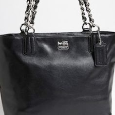 authentic Coach black leather small tote Classy black Leather Coach tote with silver chain.  Very lightweight. Coach Bags Totes