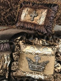Luxury Accent Pillows in chocolate brown, gold and crystal toned prints, faux croc, faux mink, velvet - embellished with braid trims, beading and jeweled medallions. By Reilly-Chance Collection