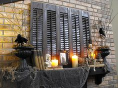 spooky mantle - love the shutters and twig arrangements