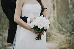 Simple and beautiful white roses bouquet for a Pronovias dress