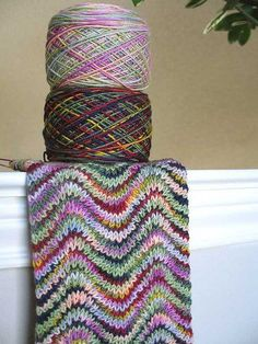 knit ripple scarf with 2 variegated yarns (would have never thought to put these two together, but wow!) link to basic ripple pattens: www.lionbrand.com....