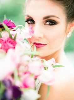 Stunning bold lips and eye makeup for this beautiful bride!