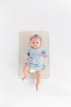 Hype over STRIPE : Charcoal lined bands of timelessness on a bed of pearl white. A little luxury diaper changing mat for the precious babies whose bottoms will soon be changed on them. Stores compactl