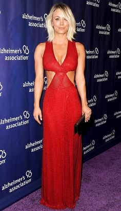 KALEY CUOCO wears an abs-baring cutout red Naeem Khan gown and black clutch at the Alzheimer's Association Night of Stars in Beverly Hills.