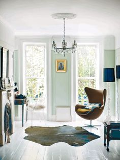 I really love the aqua with the teal with the white floorboards and tan egg chair and gold picture frame.