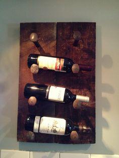Reclaimed wood and rail spike wine holder.