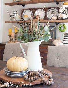 Easy peasy fall centerpiece || Worthing Court Eucalyptus, wheat and feathers!