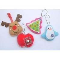 Felt ornaments - pic for inspiration. I especially like the little apple with the patch and button.