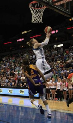 Minnesota guard Lindsay Whalen opened the game with a steal against Lindsey Harding that led to a fast break layup. (Photo by Matthew Fleegel)