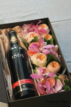 Flower box with wine. By Tempting Tulips Who can resist pretty flowers and a bottle of wine :)