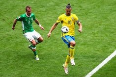 Zlatan Ibrahimovic of Sweden controls the ball under pressure of Glenn Whelan of Republic of Ireland during the UEFA EURO 2016 Group E match between Republic of Ireland and Sweden at Stade de France on June 13, 2016 in Paris, France.