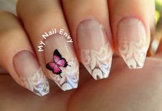 Butterfly Lace Nails – My Nail Envy  #acrylicnails #butterflynails #lacenails #nailart #negativespace #predesignedtips #springnails #summernails #waterdecals #pixiecrystals