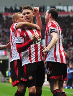 Connor Wickham of Sunderland celebrates scoring his second goal with team mates during the Barclays Premier League match between Sunderland ...