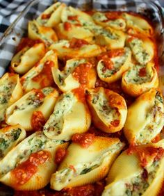 Super Stuffed Shells. Italian shells stuffed with sausage, spinach, roasted garlic, and sun-dried tomatoes. Small Town Girl Blog