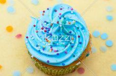 close-up shot of blue cupcake with icing. - Close-up top view of cupcake with blue cream and sugar icing.