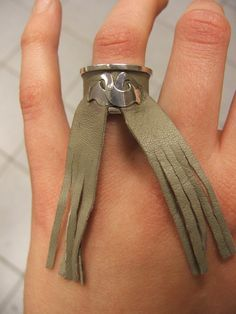 Silver ring with leather