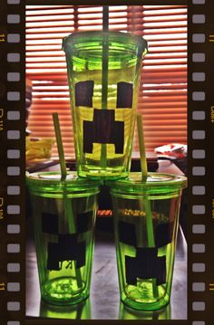Minecraft Creeper tumblers! Made for Ryan's friends for the birthday sleepover.  Dollar tree cups. Tip:  use a sharpie or other permanent marker instead of trying to spray paint lol what a frekin mess!!!!!!!