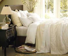 Pottery Barn Bedding. I love all the neutral colors on the bed. Looks so comfy!