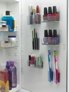 INSIDE THE CUPBOARD DOOR: Using hooks, plastic containers, or magnets, you can tidy away toothbrushes and other slim objects to maximise the amount of cupboard space you can use.