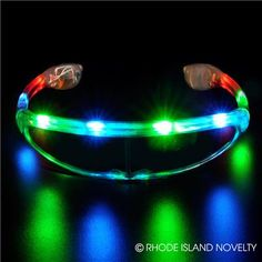 LIGHT-UP RAINBOW GLASSES Become a walking light show at your next event with our Light-Up Rainbow Glasses! These glasses come with three different light settings and can be paired with glow sticks, glow gloves, and light-up rings. Perfect for your next party or concert! Batteries included. Ages 5+ #halloween #trickortreat #lightupglasses #costumeaccessories