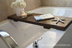 Make a cheap and easy bathtub tray for wine + book baths. | 31 Cheap Tricks For Making Your Bathroom The Best Room In The House