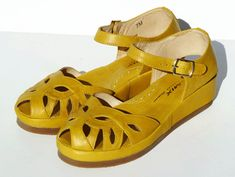 """Our super comfortable low wedge sandal with a """"cushion crepe"""" style sole, plus cushion arch for extra comfort. Intricately woven vamp with cut-outs make it a s"""
