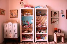 I actually have this bookshelf in my room! I love the idea of having an assortment of pretty wallpaper to decorate the shelves!
