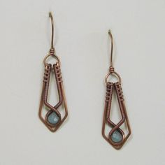SALE - original price $ 48.00. Sweet Amazonite briolettes accent these woven copper wire dangle earrings. The copper wire frame has been hand formed, hammered, sanded and polished specifically for the lovely Amazonite briolette beads. Patina has been used to soften the bright copper wire for a warm antique look. The earrings measure about 2 1/8 inches from the top of the ear wire to the bottom of the design and 1/2 inch at the widest part of the dangle. Color may vary due to mo...