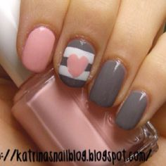 Gray & pink nails with one finger featuring nail art with stripe & heart detail. With this color choice, I still think it is a neutral design & color palette.