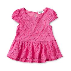 Pink ruffled shirt by Tori Spelling