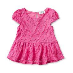 Pink ruffled shirt by Tori Spelling