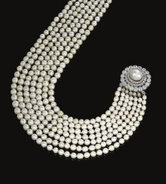 PROPERTY FROM THE ESTATE OF THE LATE PRINCE KINSKY -  Important natural pearl and diamond necklace, circa 1880 - Composed of seven graduated rows of natural pearls, to a clasp of concentric design set with circular-cut and cushion-shaped diamonds and a natural pearl, length of the shortest row approximately 380mm. [Sold for 1,222,818 USD]